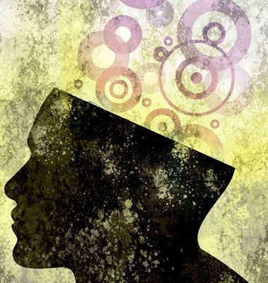 drawing of a person's head in silhouette. The top of the head has been cute off, and there are randomly sized circles being released from the head indicating thought, creativity, ideas, genius, etc.